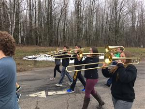 marching tombone players