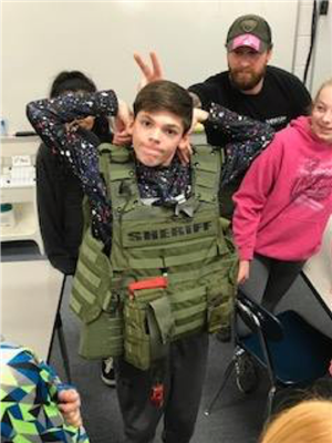 student learning from bomb squad experts
