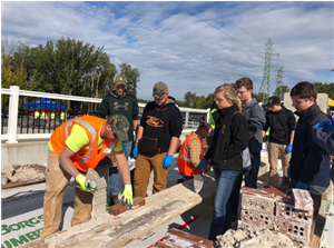 students in brick laying competition