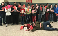 students posing with valentines cards