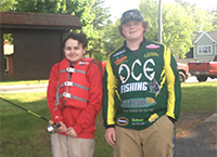 high school student and special needs student at fishing tournament
