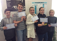 Students posing with math competition certificates.